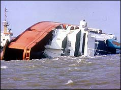 The Director of Public Prosecutions to bring charges for manslaughter against P&O ferries and seven directors and crew over the sinking of the Zeebrugge Herald of Free Enterprise when hundred and 93 people died when the bow doors were left open.
