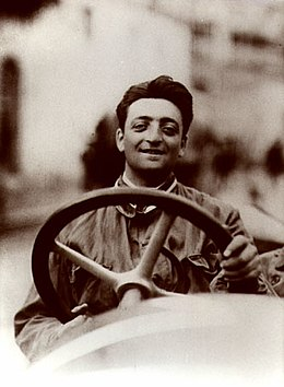Enzo Ferrari, founder of the mark, in his prime at the wheel of a racing car