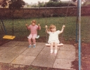 Debbie and Della on the swings 1986