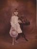 Debbie standing holding hat in studio, 1982