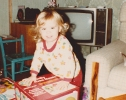 Debbie opening a present Christmas 1981