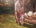 Alf with little girl and turkeys