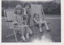 Freda with daughters Jane and Stacey on deck chairs