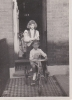 Me and Freda with my trike and  Snowball outside Napier Road 1953