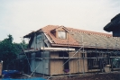 Harnser roof tiling underway. Side wall now felted and battened ready for cladding late 1992